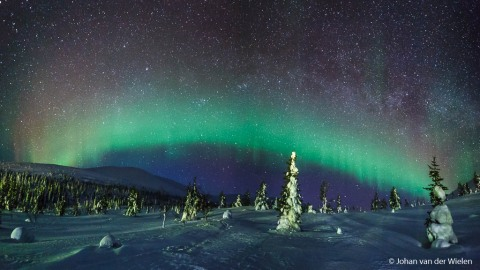 panorama (2 images) of the northern lights at Pallastunturi, Lapland, Finland