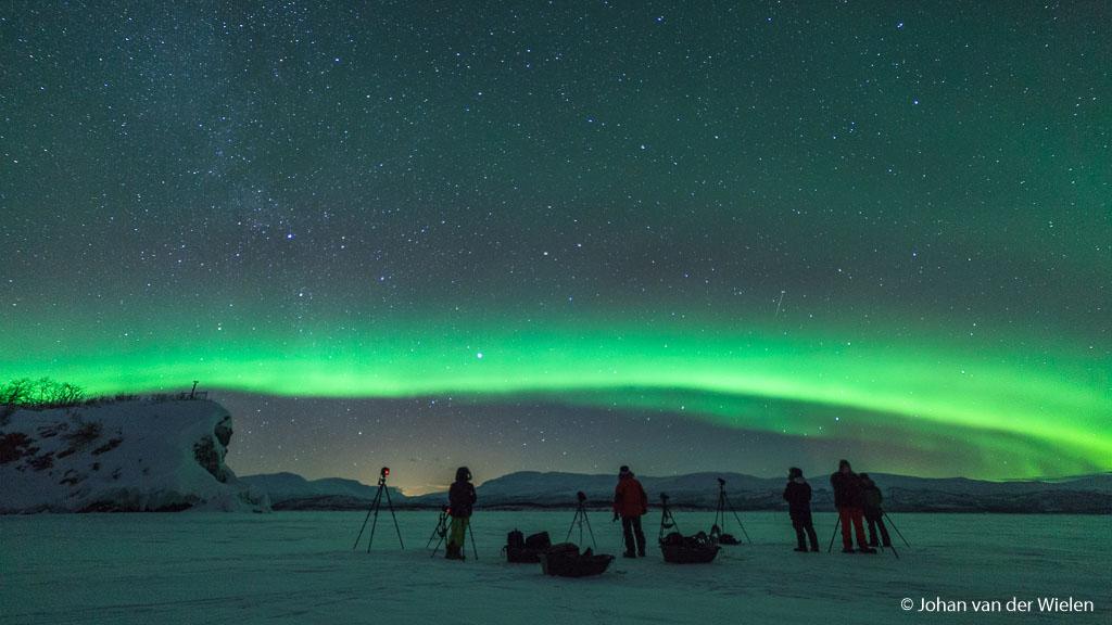 aurora shooting on the frozen lake near Abisko, Sweden
